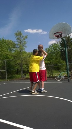 Big J Teaching Little J Basketball
